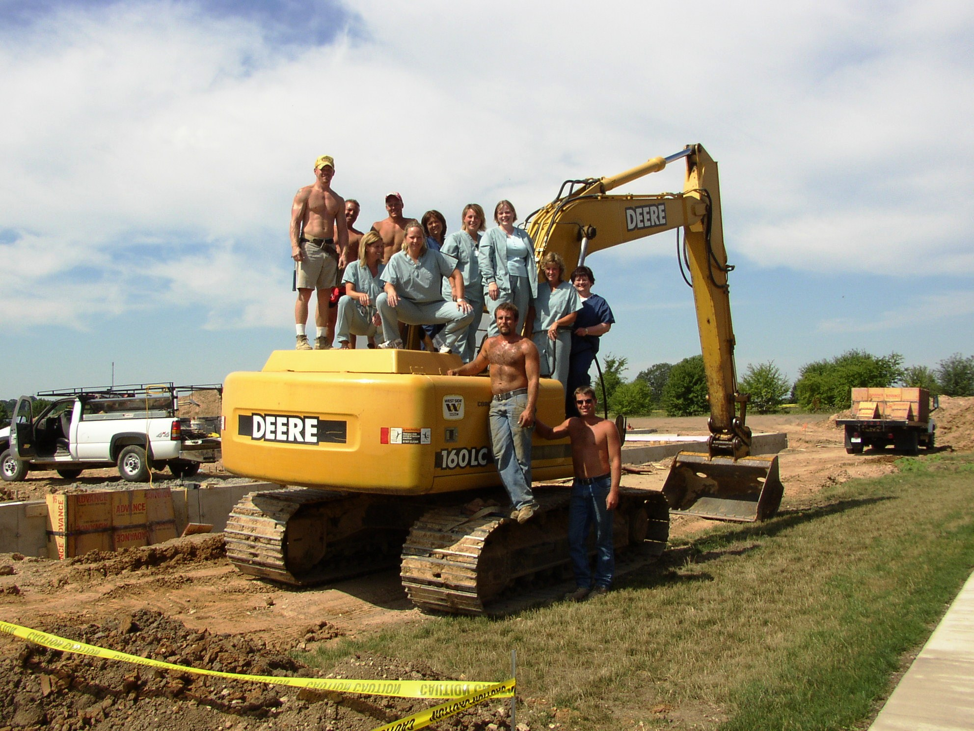 The first ROSC employees pose with the construction crew